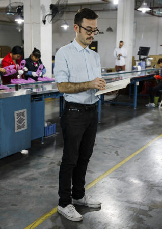 Thomas sketching at a factory in Dongguan China, 2014 - Photo By Philippe Fragniere